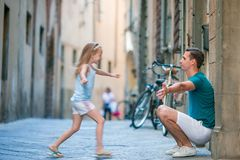 Happy father and little adorable girl in Rome during summer italian vacation stock photo