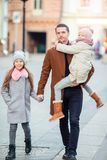 Happy father and little adorable girl in the city outdoors royalty free stock photos