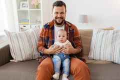 Happy father with little baby boy at home royalty free stock photography