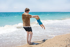 Happy father and little baby son having fun at beach vacation Stock Images