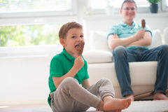 Happy father and little boy eating ice-cream Royalty Free Stock Photography