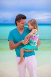Happy father and little daughter at white sandy Stock Photography