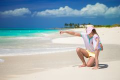 Happy father and little daughter at white sandy Stock Image