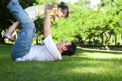 Happy father and little girl. Happy asian father and little girl on the grass Stock Image