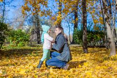 Happy father and little girl in autumn park Royalty Free Stock Images