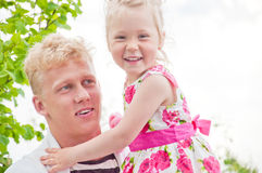 Happy father and little girl at a garden Stock Images