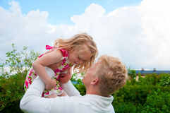 Happy father and little girl at a garden Royalty Free Stock Image
