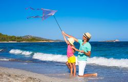 Happy father and little girl playing with kite on Stock Image