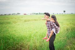 Happy Father and little girl playing at the meadows field, enjoy Royalty Free Stock Images