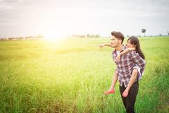 Happy Father and little girl playing at the meadows field, enjoy Royalty Free Stock Photography