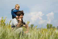 Happy father and little son on the field Stock Image