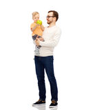Happy father and little son with green apple Royalty Free Stock Photos