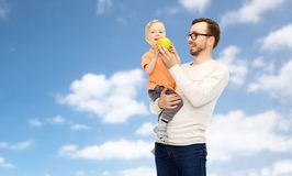 Happy father and little son with green apple Stock Photos