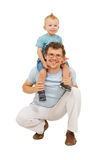 Happy father with little son on his neck Royalty Free Stock Photos