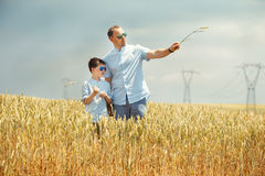 Happy father with little son walking happily in Royalty Free Stock Photo