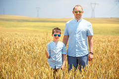 Happy father with little son walking happily in Royalty Free Stock Photography
