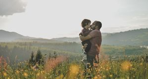 Son with father on mountain. Happy father and little son are walking in the mountains Royalty Free Stock Photos