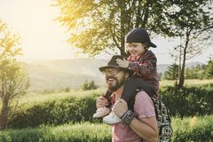 Son with father on mountain. Happy father and little son are walking in the mountains Royalty Free Stock Photo