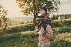 Son with father on mountain. Happy father and little son are walking in the mountains stock images
