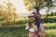 Son with father on mountain. Happy father and little son are walking in the mountains stock photography