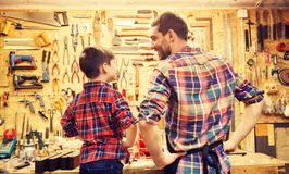 Happy father and little son workshop royalty free stock image
