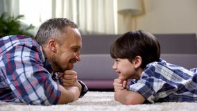 Happy father looking at son, spending time together on weekend, fatherhood royalty free stock photos