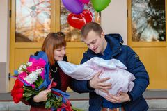 Happy father meets his wife with a newborn baby. Grodno, Belarus - December 13, 2017: Happy father meets his wife with a newborn baby in perinatal center of stock photography