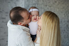 Happy father and mother with baby Royalty Free Stock Photos