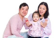 Happy father and mother holding baby daughter hand royalty free stock image