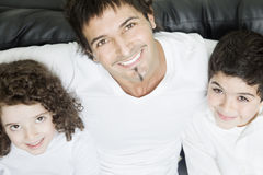 Happy father and offsprings. Smiling Stock Photo