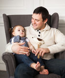 Happy father with one year old baby girl indoor Stock Photo