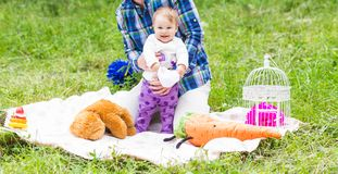 Happy father play with adorable little baby daughter in nature stock image