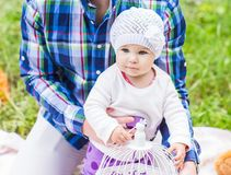 Happy father play with adorable little baby daughter in nature royalty free stock photo