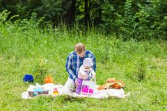 Happy father play with adorable little baby daughter in nature royalty free stock image