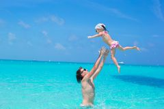 Happy father play with little daughter in perfect sea Royalty Free Stock Photo