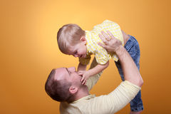 Happy father play with son. Happy father play with his son royalty free stock images