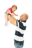 Happy father playing with baby Stock Photos