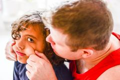 Happy father playing with boy in kitchen. Funny faces happy days Royalty Free Stock Photos