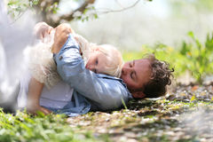 Happy Father Playing with Cute Baby daughter in Autumn Woods Stock Photography