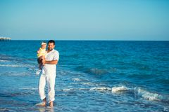 Happy father playing with cute little daughter at the beach. Rest in Turkey royalty free stock photos