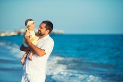 Happy father playing with cute little daughter at the beach. Rest in Turkey royalty free stock photo