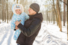 Happy father playing with little child son boy in winter nature Stock Photo