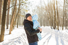 Happy father playing with little child son boy in winter nature Royalty Free Stock Photography