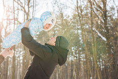 Happy father playing with little child son boy in winter nature Royalty Free Stock Images