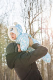 Happy father playing with little child son boy in winter nature Stock Photography