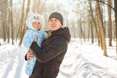 Happy father playing with little child son boy in winter park Royalty Free Stock Image