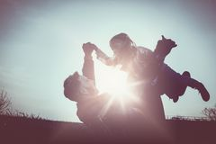Happy father playing and lying on grass with his daughter. Litt stock photos