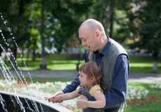Happy father plays with child Stock Photo