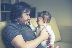 Happy father plays with his baby at home Royalty Free Stock Photography