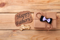 Happy Father`s card and gift. Pyrography car near bow tie. Dad will appreciate your endeavor Royalty Free Stock Photography